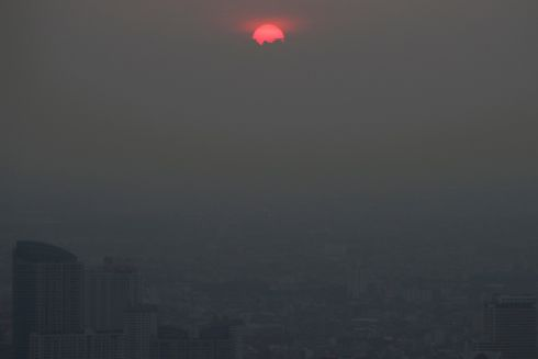 BEFORE SUNSET: A sunset is seen during a day of poor air quality in Bangkok, Thailand. Photograph: Jorge Silva/Reuters