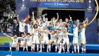 Real Madrid players celebrate with the Fifa Club World Cup trophy. Photograph:PA