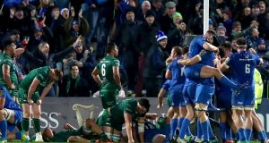 Leinster players celebrate Andrew Porter's winning try. Photograph: James Crombie/Inpho