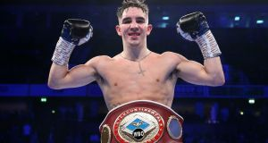 Michael Conlan celebrates victory over Jason Cunningham with his WBO Intercontinental Featherweight Championship belt. Photograph: Alex Livesey/Getty Images
