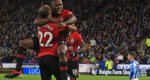 Southampton's Irish-born striker Michael Obafemi with Nathan Redmond after scoring his first Premier League goal. Photograph: Getty Images