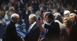 President Jimmy Carter is congratulated by Senator Robert Drinan and presidential candidate senator Ted Kennedy after giving a speech at the Democratic National Convention, New York, August 1980. Photograph:  David Hume Kennerly/Getty