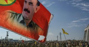 A flag depicting Abdullah Öcalan, founder of the Kurdistan Workers' Party. Photograph: Mauricio Lima/The New York Times