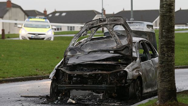 Garda preserve a burnt out Volkswagen Jetta found at Rusheeney Estate near Clonee, following the killing in west Dublin. Photograph: Stephen Collins/Collins Photos