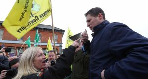 A woman confronts Sinn Féin MEP Matt Carthy as he addresses the crowd. Photograph: Brian Farrell