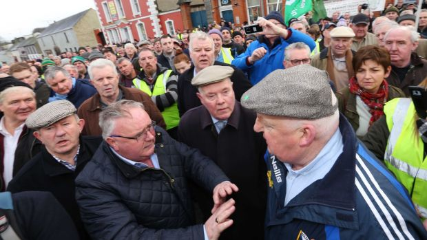 Fianna Fail TD Eugene Murphy is confronted by a protester after addressing the crowd. Photograph: Brian Farrell