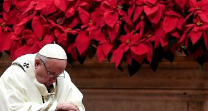 Pope Francis prays as he celebrates the Christmas mass marking the birth of Jesus Christ on December 24th, 2018 at St Peter's basilica in Vatican. Photograph: Tiziana Fabi/AFP/Getty Images