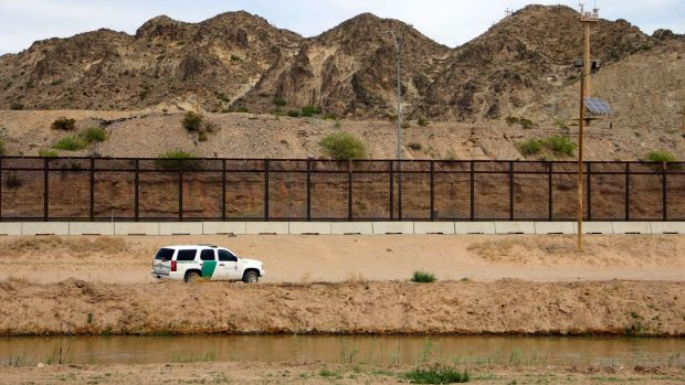 A US Border Patrol, seen from Mexico, patrolling along the border line between El Paso, Texas, and Ciudad Juarez in Mexico. Photograph: Herika Martinez/AFP/Getty Images)