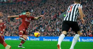 Liverpool's Dejan Lovren scores against Newcastle United at Anfield. Photograph: EPA