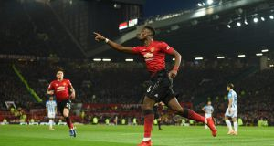 Manchester United's French midfielder Paul Pogba celebrates scoring against Huddersfield. Photograph: Getty Images