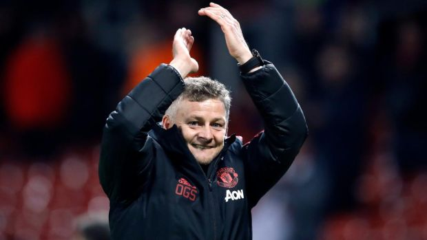 Manchester United interim manager Ole Gunnar Solskjær celebrates the win after the Premier League match against Newcastle. Photograph: Martin Rickett/PA Wire