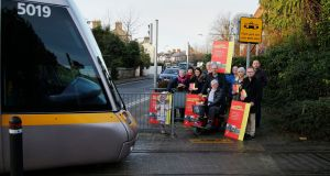 Metrolink opponents Rethink Metrolink at Beachwood Luas Stop. From left: Grace Maguire, Suzanne Gleeson, Michael Brady, Philip Daly, Eugene Flynn, Ruth Murphy, Colleen McCarthy, Larry Ryan and Ronan O'Connell. The child in the foreground is Mary Kate Gleeson. Photograph: Nick Bradshaw