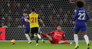 Eden Hazard scores the opener for Chelsea at Vicarage Road. Photograph: Richard Heathcote/Getty Images