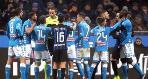 Napoli's players argue with referee Paolo Mazzoleni at the San Siro. Photograph: EPA