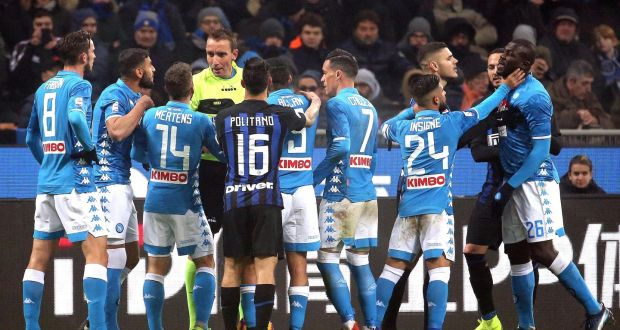 1fea34db2 Napoli s players argue with referee Paolo Mazzoleni at the San Siro.  Photograph  EPA