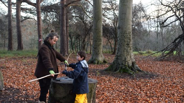 Lucy O'Hagan, forest school leader, with Samuel. Photograph: Dara Mac Dónaill / The Irish Times