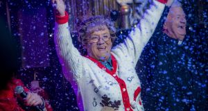 Agnes Brown (Brendan O'Carroll) celebrates 'Mrs Brown's Boys' topping the Irish Christmas television charts again. Photograph: BBC / RTÉ.
