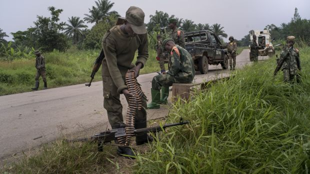 Government soldiers take a break after clashing with rebel militias in Mukoko, Democratic Republic of Congo.