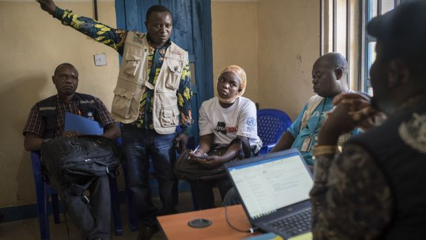 Health workers describe how a grandmother threatened them with a machete after they tried to grab a baby infected with Ebola, at the Ebola treatment center run by Doctors Without Borders in Butembo, Democratic Republic of Congo.