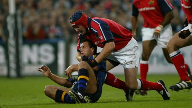 Leinster's Keith Gleeson is tackled by Anthony Foley of Munster in 2003. Photograph: Patrick Bolger/Inpho
