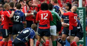 Munster forward Alan Quinlan (cap) is held back from Leinster captain Leo Cullen during the Heineken Cup semi-final  won by Leinster at Croke Park in 2009. Photograph: Stu Forster/Getty Images