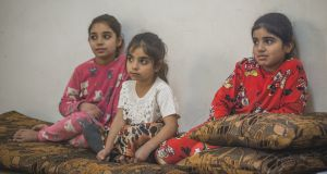 Three of Mo'een Al Ali's daughters watch on as their parents explain the barriers preventing them from going to school. Photograph: Peter Biro/European Union 2018