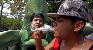 A man smokes a joint during a rally in support of the legalisation of marijuana in Guadalajara, Mexico. Photograph: Ulises Ruiz/AFP/Getty Images