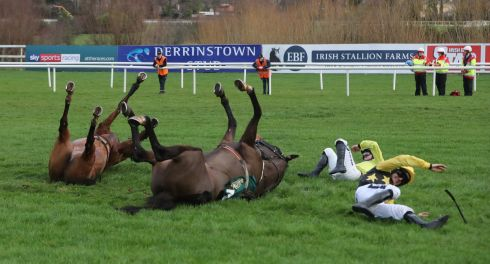 HEELS OVER HEAD? Bacardys, ridden by Ruby Walsh, and Borderline Chatho, ridden by Donagh Meyler, tumble at the last during The Ballymaloe Foods Beginners Steeplechase on day three of the Leopardstown Christmas Festival at Leopardstown Racecourse. Photograph: Niall Carson/PA Wire