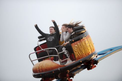 A BIT LIKE LIFE: Youngsters get a feel for things on a rollercoaster ride at Funderland, at the RDS in Dublin. Photograph: Aidan Crawley/The Irish Times