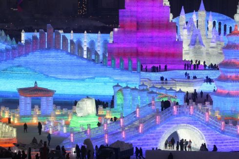 People visit illuminated ice sculptures at the Ice and Snow World park ahead of the Harbin International Ice and Snow Sculpture Festival, in Harbin, Heilongjiang province, China. Photograph: Reuters