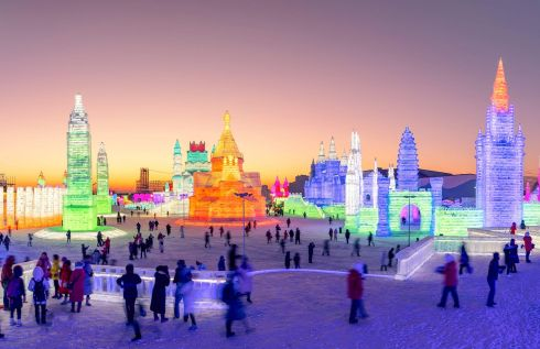 People visiting the Harbin Ice-Snow World in Harbin, China's northeastern Heilongjiang province.  (Photo by STR / AFP) /STR/AFP/Getty Images