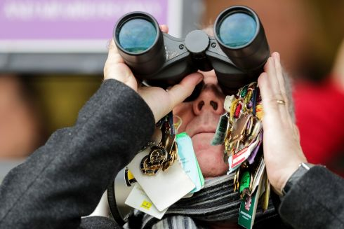 MESMERISED: A racegoer takes the racing action in at Leopardstown. Photograph: Laszlo Geczo/Inpho