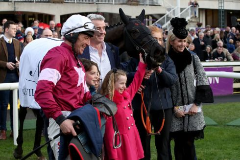 ALL SMILES: Delta Work, winner of the Neville Hotels Novice Steeplechase, ridden by Davy Russell, with Michael O'Leary and his family. Photograph: Bryan Keane/Inpho