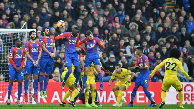 Willian's first-half free-kick hits the post at Selhurst Park. Photograph: Ben Stansall/AFP/Getty