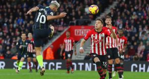 Sergio Aguero scores Manchester City's third goal against Southampton. Photograph: Catherine Ivill/Getty