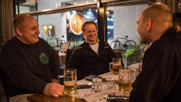 After soccer practice, Antti Raunemaa, from left, Nicke Tevajarni and Johan Hilli have a drink at Moms, the only late-night bar in Kauniainen, Finland. Photograph: (Lena Mucha/The New York Times
