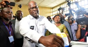 Felix Tshisekedi, leader of the Congolese main opposition party, the Union for Democracy and Social Progress, casts his ballot at a polling station in Kinshasa. Photograph: Olivia Acland/Reuters