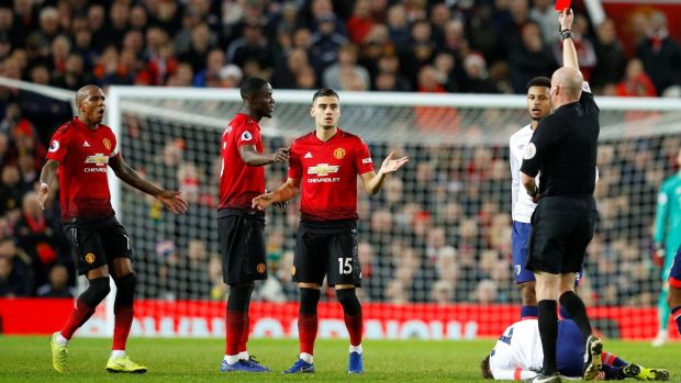 Eric Bailly was shown a red card late on. Photo: Phil Noble/Reuters