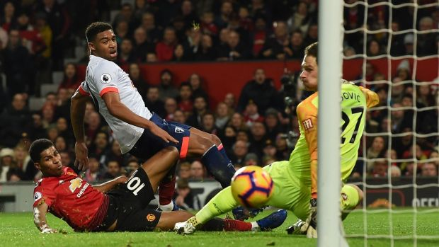 Rashford slides in to score United's third. Photo: Paul Ellis/AFP