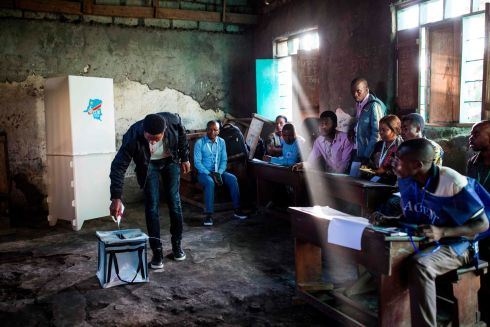 UNDER SCRUTINY: A man casts his ballot at the Katendere voting centre in Goma, Democratic Republic of Congo, after what has been a tense election campaign. Photograph: Patrick Meinhardt/AFP/Getty Images