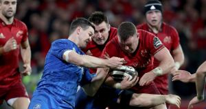 Munster's Dave Kilcoyne with Leinster's Johnny Sexton at Thomond Park, Limerick on Saturday. Photograph: Dan Sheridan/Inpho