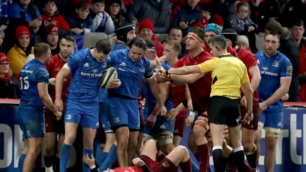 Tempers flare between Leinster's Jonathan Sexton and Munster's Joey Carbery during the Pro14 encounter at Thomond Park. Photo: Dan Sheridan/Inpho