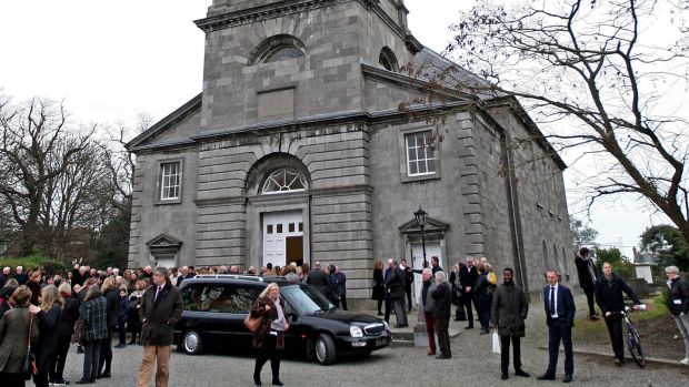 Mourners gather at at St Peter's Church, Drogheda, Co Louth, on New Year's Eve for the funeral of former Irish Times journalist Eileen Battersby. Photograph: Donall Farmer
