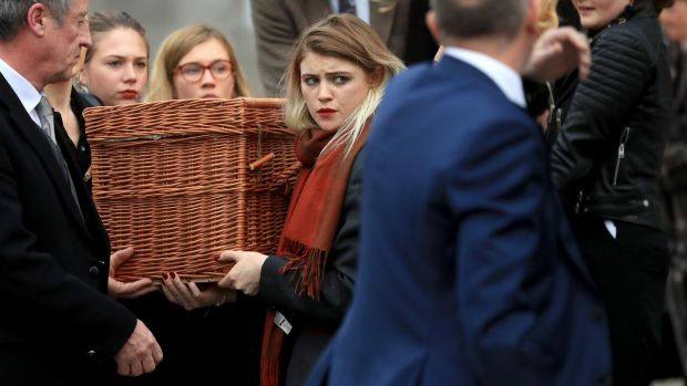 Eileen Battersby's daughter helps bear her mother's remains on the final journey. Photograph: Donall Farmer