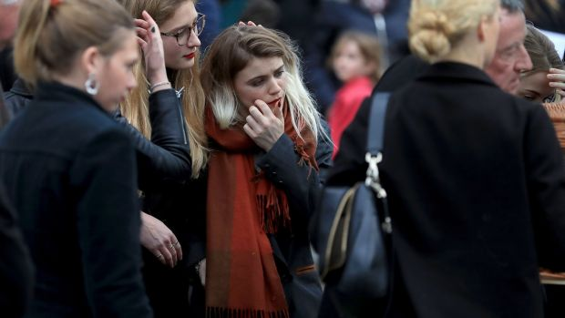 Eileen Battersby's daughter Nadia among grieving mourners. Photograph Donall Farmer