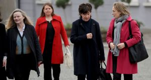 Former Irish Times colleagues Bernice Harrison, Kathy Sheridan (third from left) and Joyce Hickey arrive for the funeral. Photograph: Donall Farmer