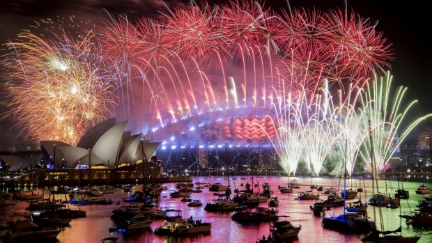 Fireworks explode over the Sydney Harbour during New Year's Eve celebrations in Sydney, Australia. Photograph: AAP