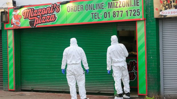 7a1b68182861 Garda Forensic experts at the scene of the shooting at Mizzoni s Pizza in  Edenmore in Dublin