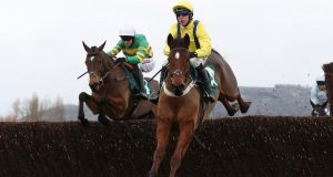 Lostintranslation and Robbie Power (R) jump ahead of Defi Du Seuil and Barry Geraghty. Photograph: David Davies/PA