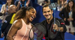 Serena Williams and Roger Federer take a selfie after their mixed doubles meeting in Perth. Photograph: Tony Ashby/AFP/Getty
